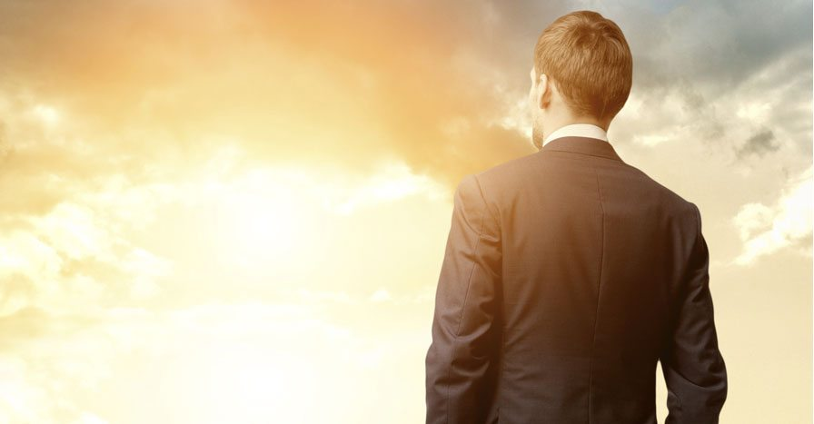 man in suit looking at the sky
