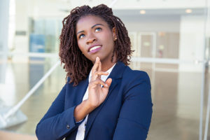 woman thinking in suit