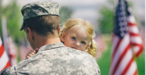 Soldier holding a baby