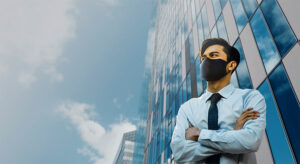 Man in mask outside of building