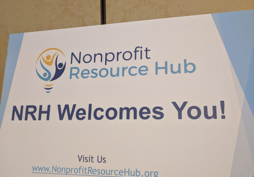 "photo of sign that says ""nonprofit resource hub welcomes you"""